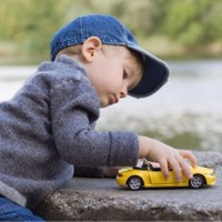 little-boy-playing-with-toy-car