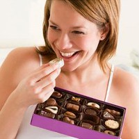 woman-eating--box-of-chocolates-136380870108110401-130529115345